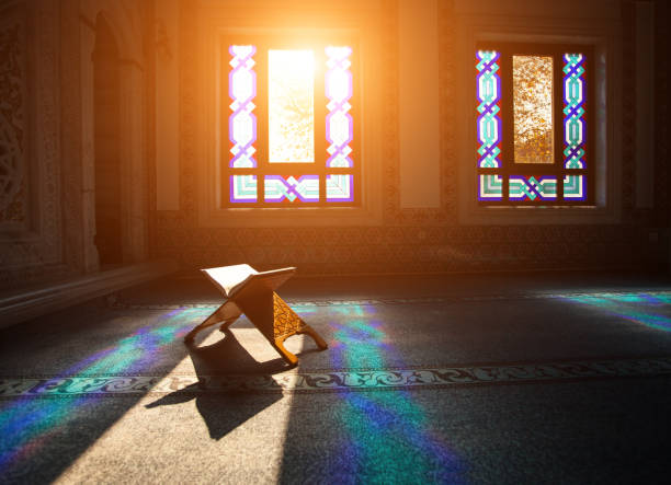 Quran in a mosque Quran - holy book of muslims, scene in the mosque at Ramadan time islam stock pictures, royalty-free photos & images