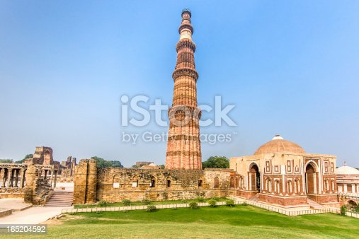 Qutub Minar Complex and Qutab Minaret Tower. The Qutub Minar was constructed in the year 1192 out of red sandstone and marble.Is the tallest minaret in India, with a height of 72.5 meters (237.8 feet). Qutub Minar, Delhi, India.