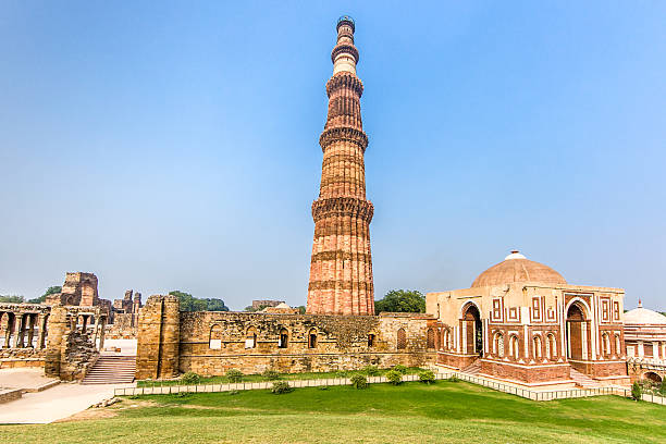 Qutub Minar Delhi India Qutub Minar Complex and Qutab Minaret Tower. The Qutub Minar was constructed in the year 1192 out of red sandstone and marble.Is the tallest minaret in India, with a height of 72.5 meters (237.8 feet). Qutub Minar, Delhi, India. minaret stock pictures, royalty-free photos & images