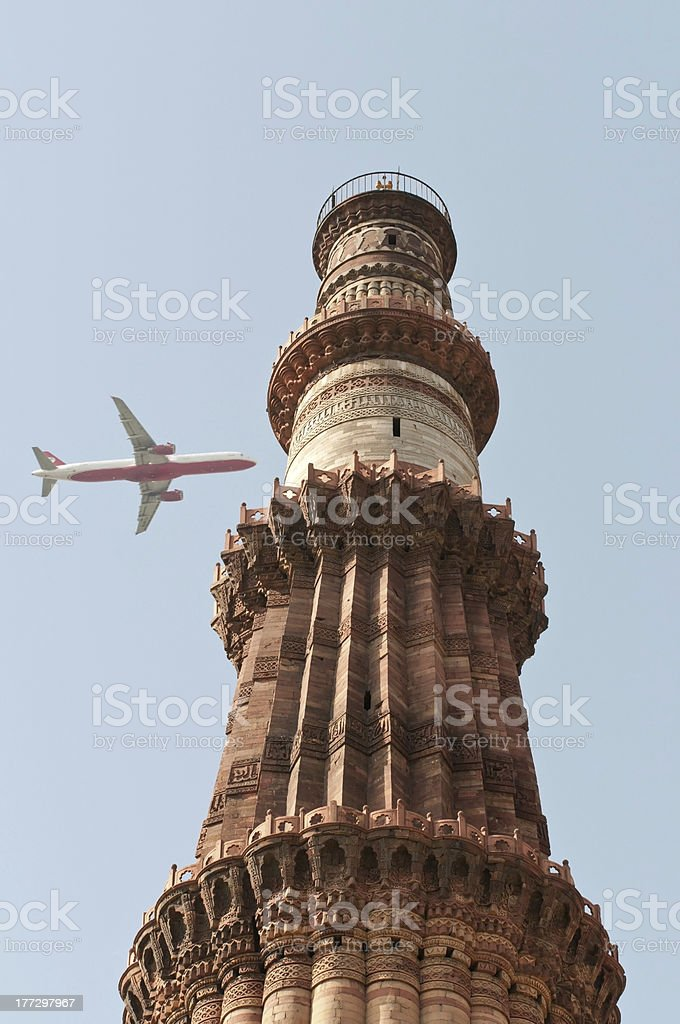 Qutub Minar with Airplane royalty-free stock photo