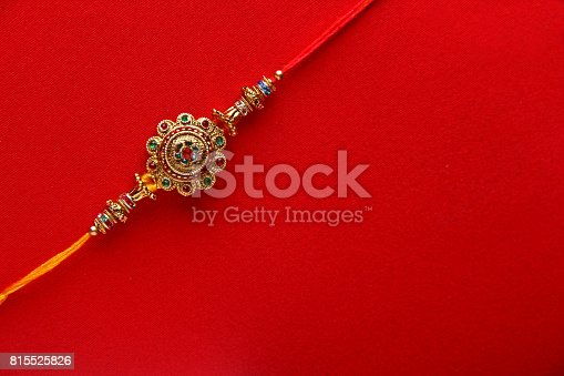 istock Raakhi on red background 815525826