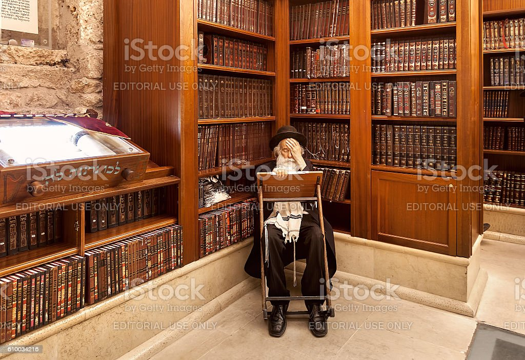 Rabbi and holy books in synagogue. stock photo