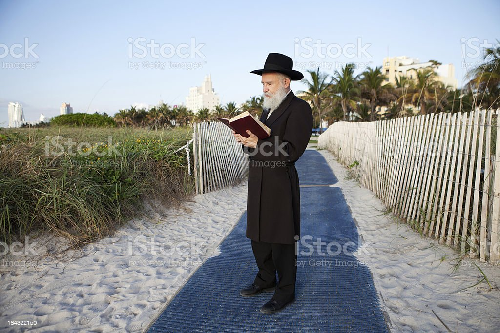 Rabbi praying on the beach stock photo