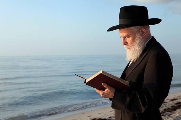 Rabbi praying stock photo