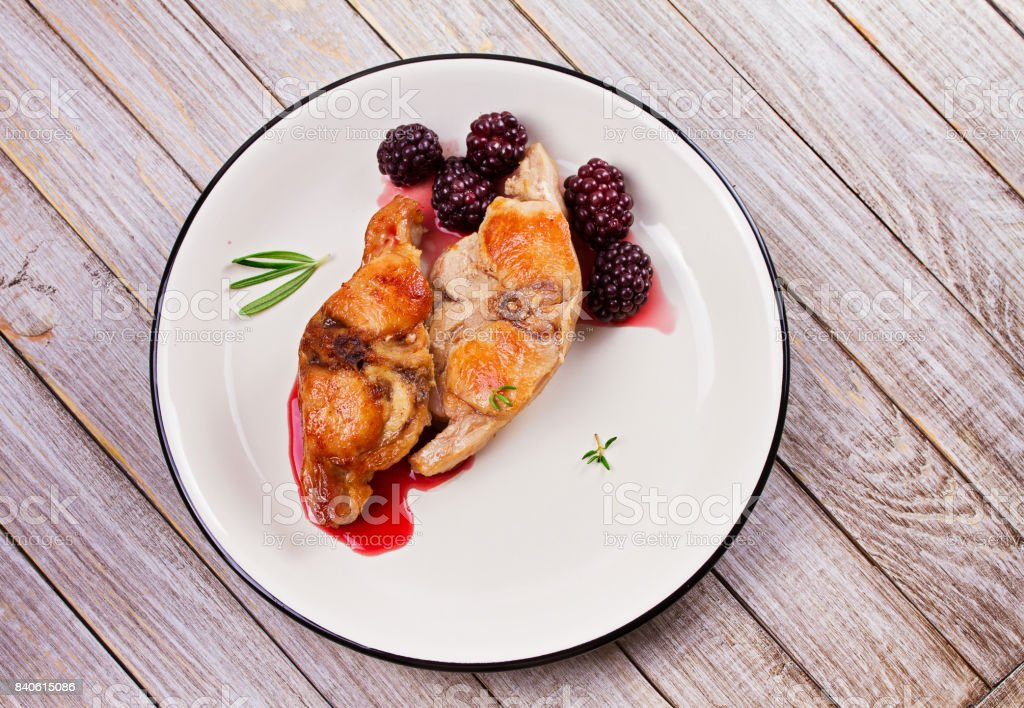 Rabbit in blackberry sauce with thyme and rosemary stock photo