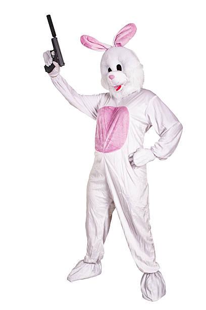 rabbit mascot with a gun. - mascotte photos et images de collection