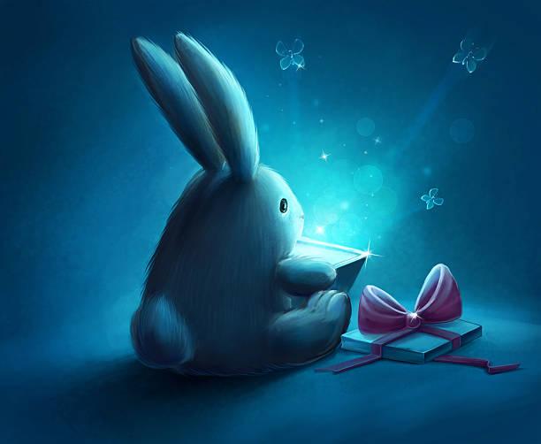 Rabbit with magic gift box stock photo