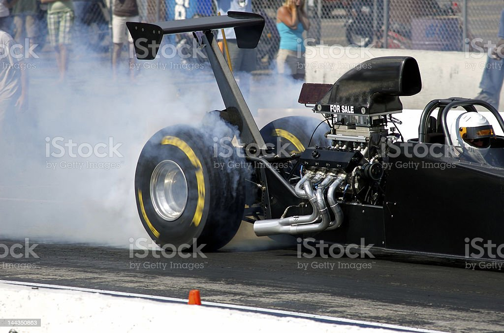 Race Car burning rubber smoking tires stock photo