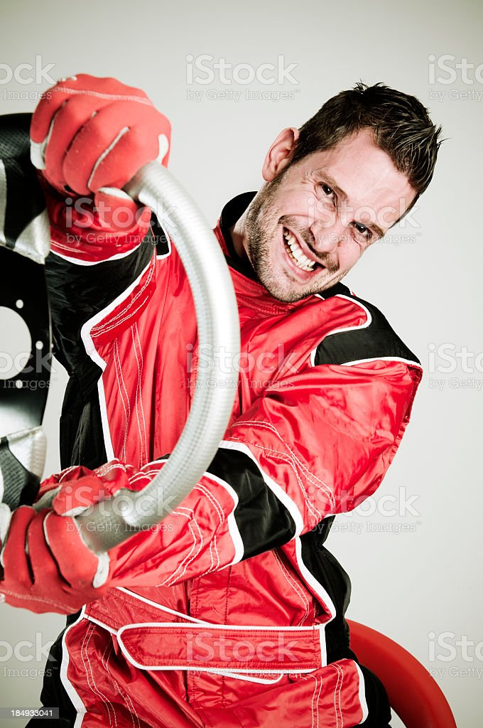 Race car driver in fire suit holding a wheel stock photo