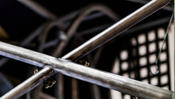 Race car frame cross bars and roll cage being assembled stock photo