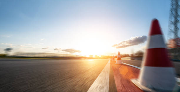 Race Car / motorcycle racetrack after rain on a sunny day. Fast motion blur effect. Ready to race stock photo