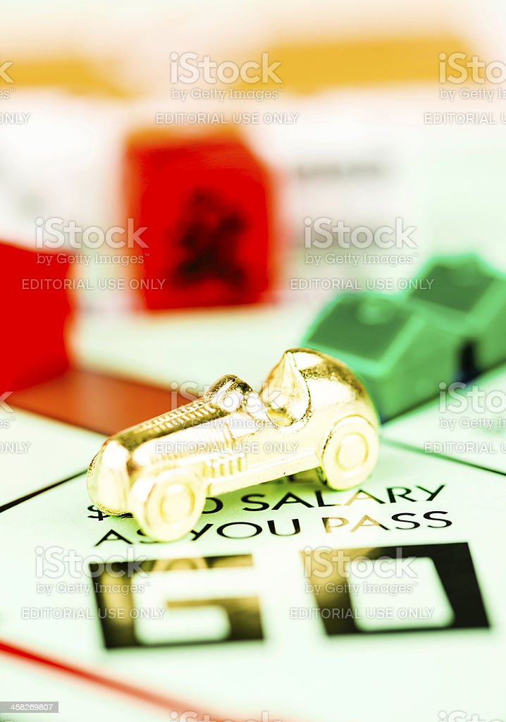 Race Car Token on Monopoly Board stock photo