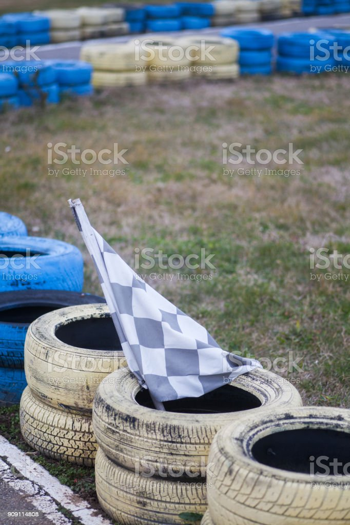 race flag on some tires stock photo