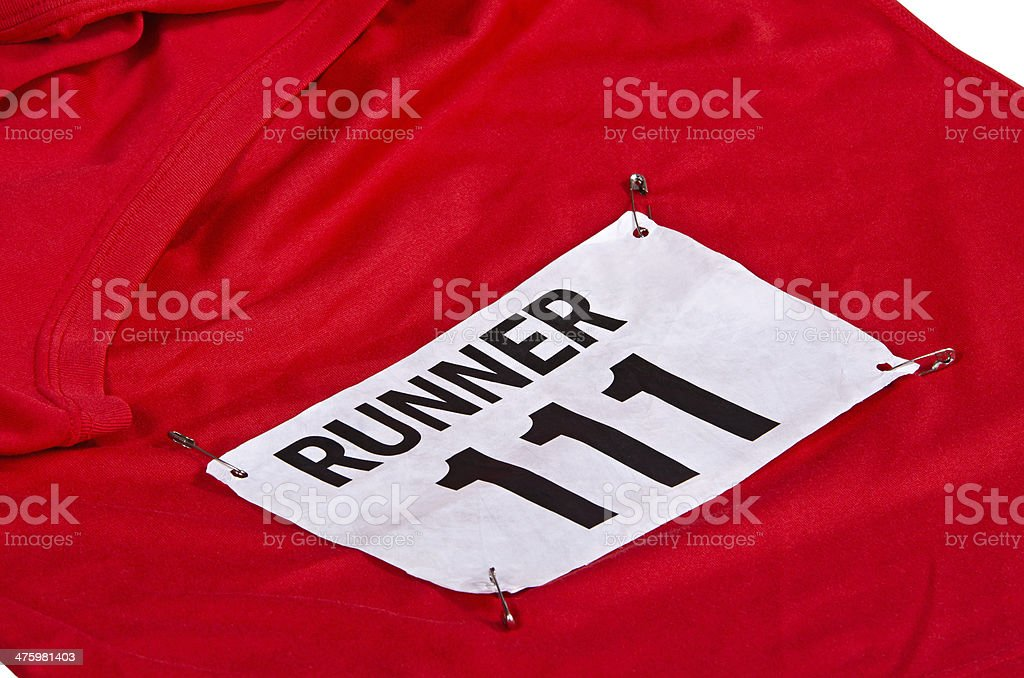 Race number on running shirt stock photo