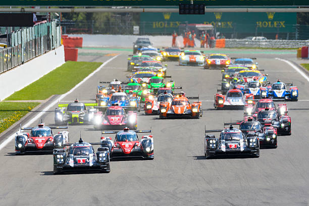 FIA WEC Race start at Spa Francorchamps Spa, Belgium - May 7, 2016: Race start of the 2016 Six Hours of Spa of the FIA World Endurance Championship at the Spa-Francorchamps race track. The Porsche 919 Hybrid race cars are leading the Toyota TS050 and Audi R18 LMP1 cars in front of the rest of the field of LMP and LM GTE race cars. The car is driving around the Spa Francorchamps race track during the WEC 6 Hours of Spa-Francorchamps. The team participates in the 2016 FIA World Endurance Championship (WEC). spa belgium stock pictures, royalty-free photos & images