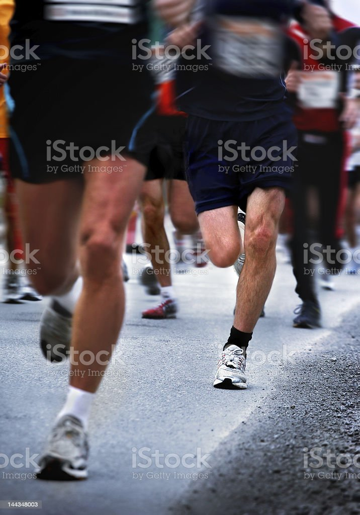 A race taking place and people running fast royalty-free stock photo