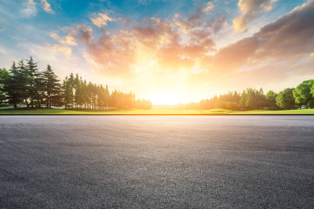 Race track and green woods nature landscape at sunset stock photo