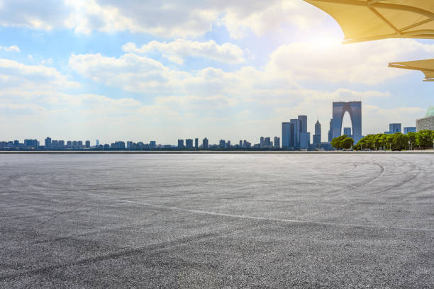 Race track ground and Suzhou city skyline on a sunny day. stock photo