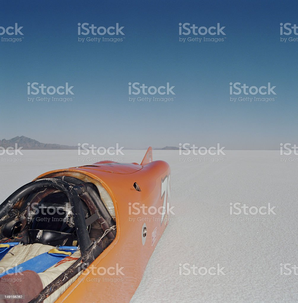 Racecar driver lying in streamliner car, elevated view stock photo