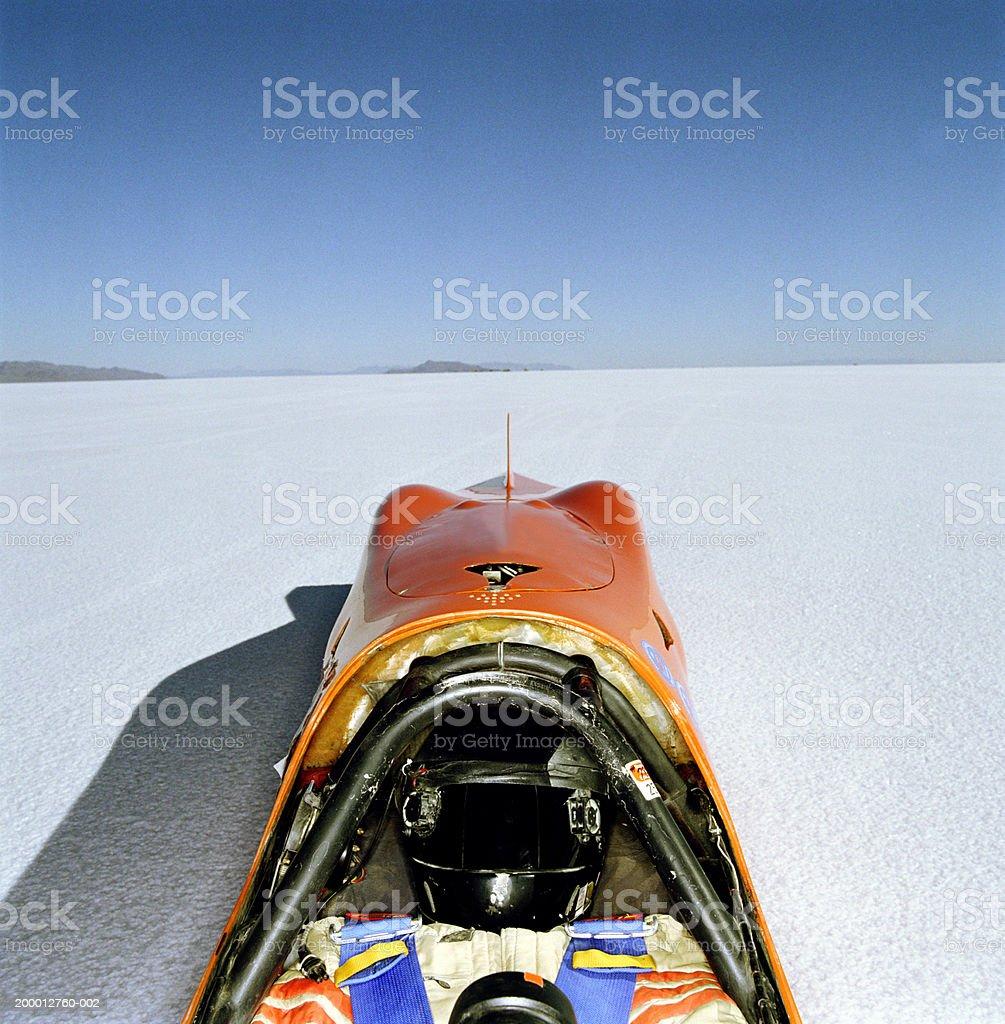 Racecar driver lying in streamliner car, elevated view, Utah, USA stock photo