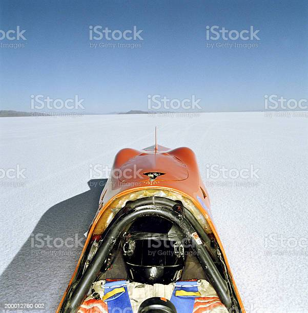 Racecar Driver Lying In Streamliner Car Elevated View Utah Usa Stock Photo - Download Image Now