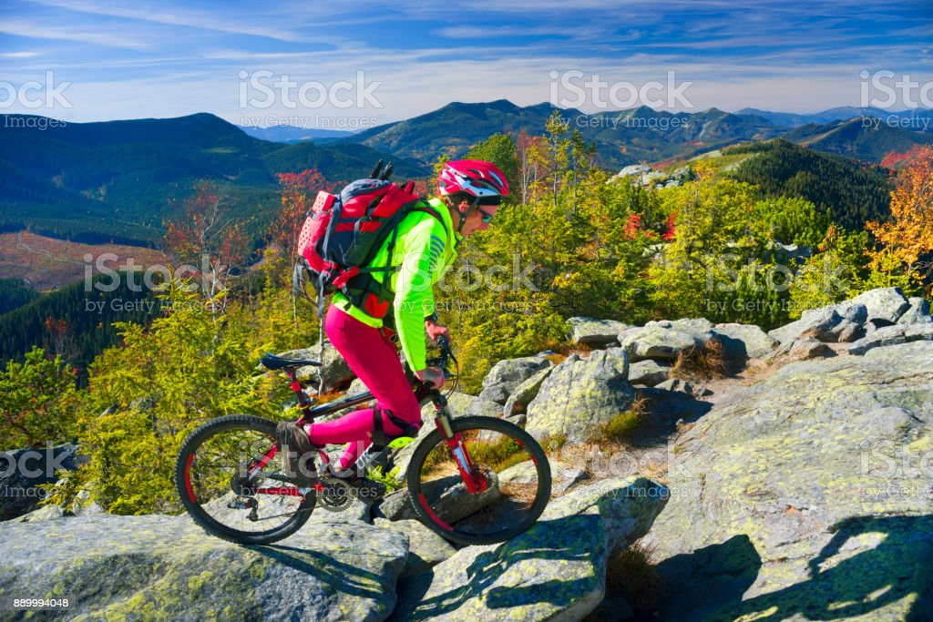 Racer and MTB on the rocks stock photo