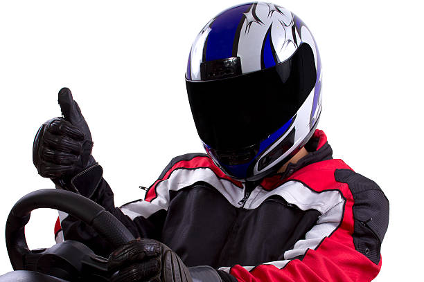 Racer in a blue and white helmet giving a thumbs up stock photo