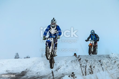 Miasskoe, Russia -  January 16, 2016: racer man on motorcycle flying over mountain after jump during Cup of Urals winter motocross