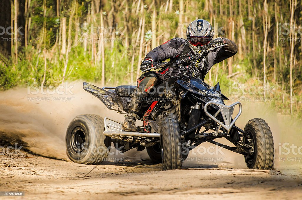 ATV racer takes a turn during a race. stock photo
