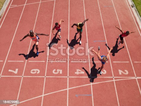 istock Racers at the start line on a track 184629980