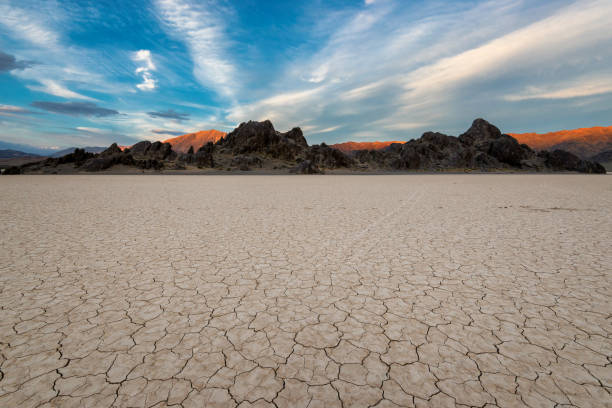 Racetrack Playa at sunset Landscape in Death Valley National Park, California lake bed stock pictures, royalty-free photos & images