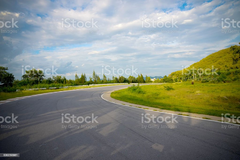 racetrack straight to the mountain with clear sky. stock photo
