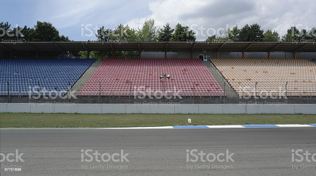 racetrack tribune with seat rows stock photo