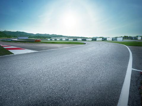 istock racetrack with city background , Sunset scene 960443808