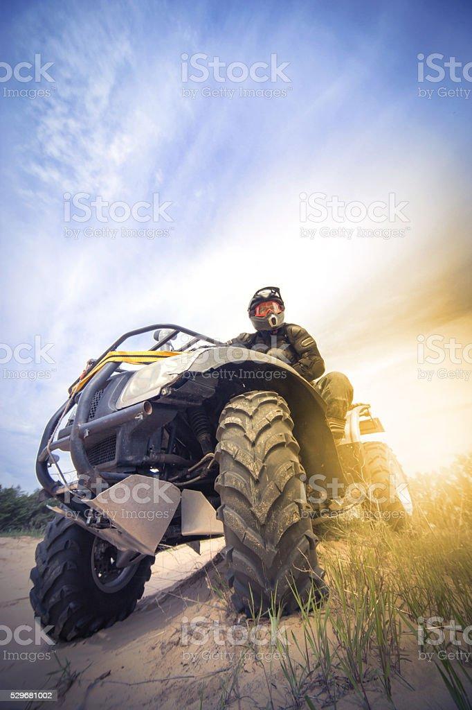 Racing ATV in the sand. stock photo