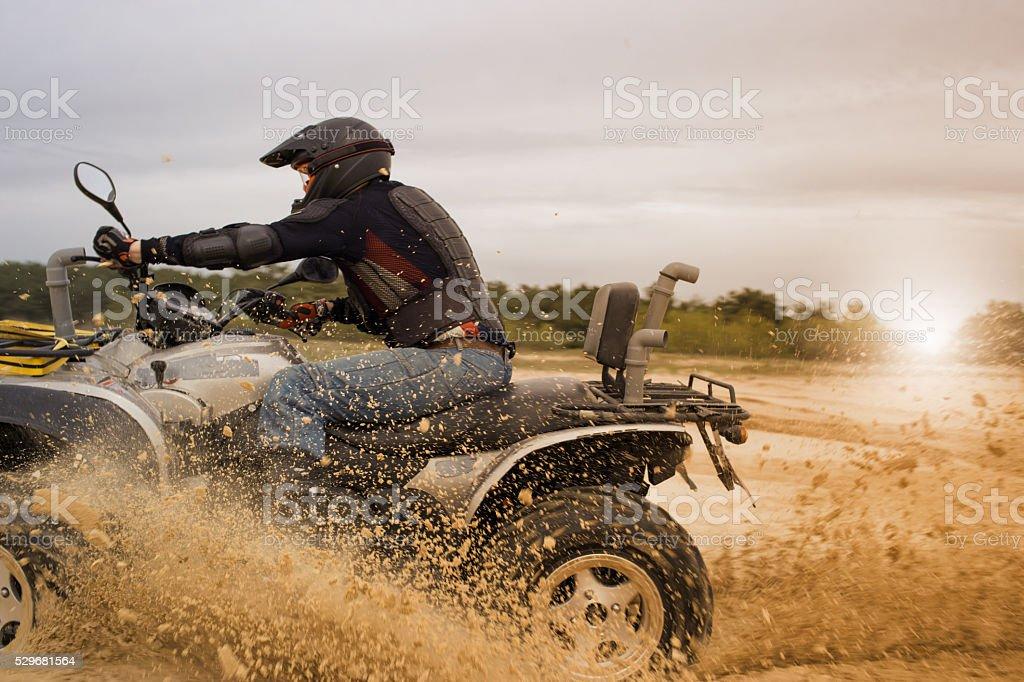 Racing ATV in the sand stock photo