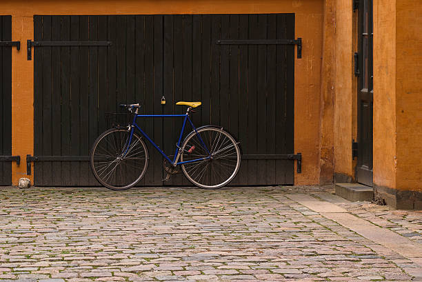 Racing bicycle parked in front of the garage stock photo