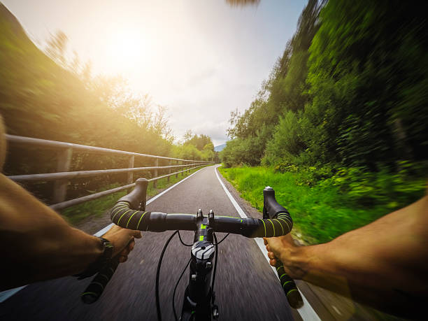 racing bicycle pov riding - gopro stockfoto's en -beelden