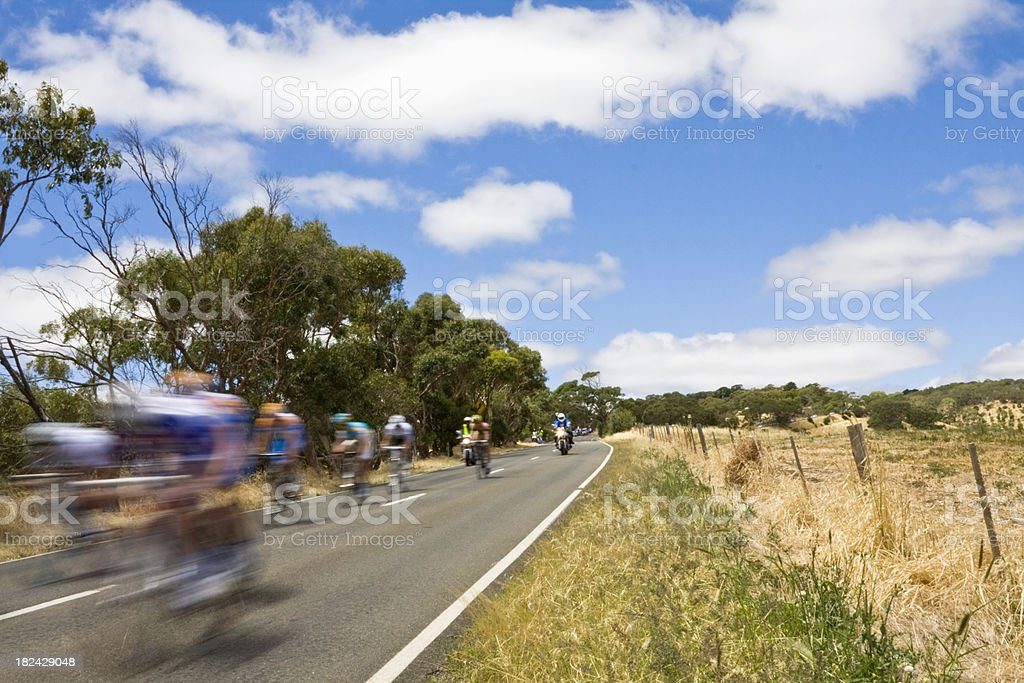 Racing bikes on a rural road, motion blur royalty-free stock photo