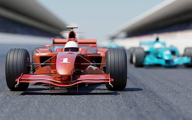 un coche de carreras en línea de salida - irl indycar series fotografías e imágenes de stock