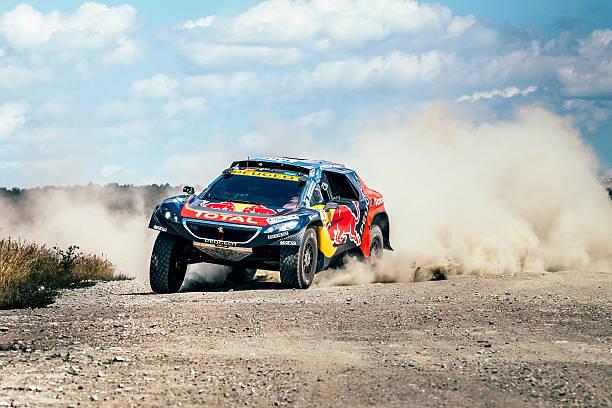racing car Peugeot driving on a dusty road - foto de stock