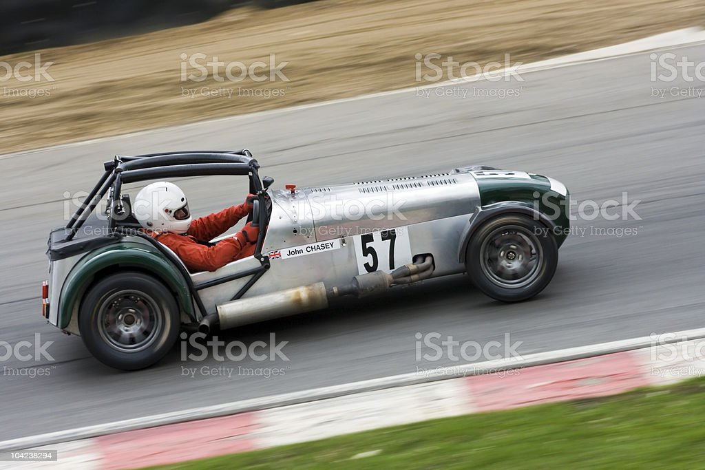 Racing car speeding along the track royalty-free stock photo