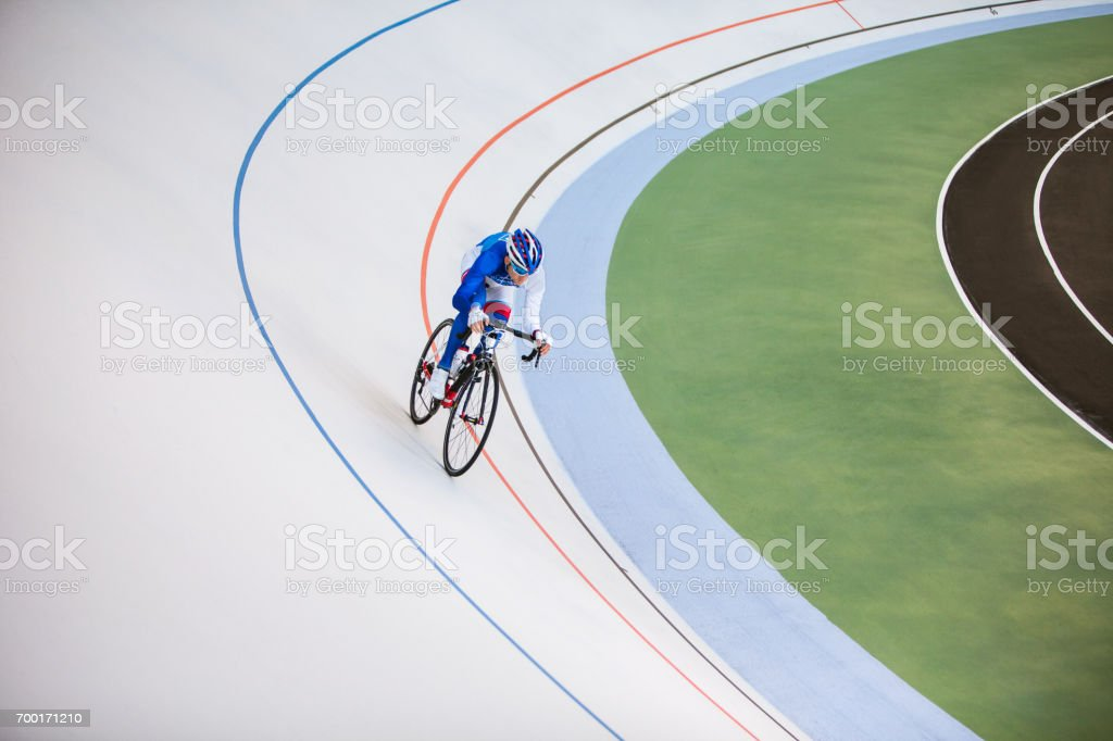 Racing cyclist on velodrome outdoor. stock photo