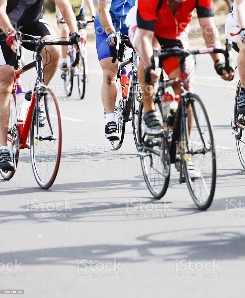 Racing cyclists power their way to the finish line royalty-free stock photo