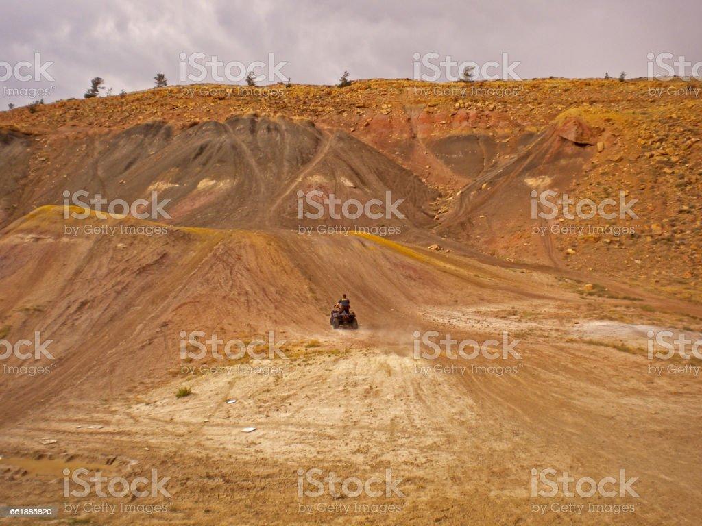 Racing on a dirt atv stock photo