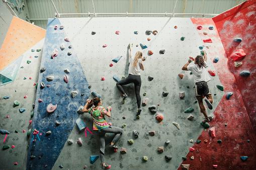 istock Racing Up The Climbing Wall 878251480