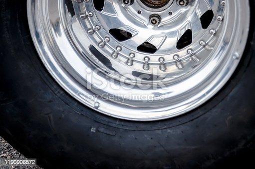 racing wheel. chrome wheel of a racing car. car racing concept. shabby racing tire