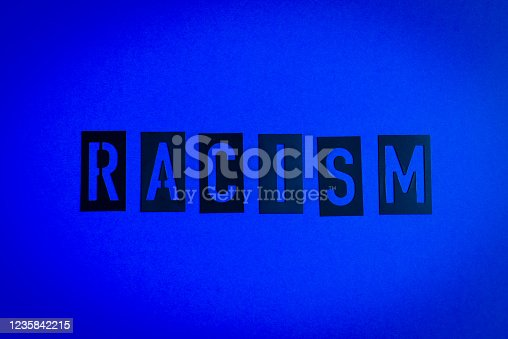 The word Racism spelled over a blue background