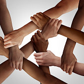 Racism and human civil rights as diverse people of different ethnicity holding hands together as a social solidarity concept of a multiracial group working as united partners.