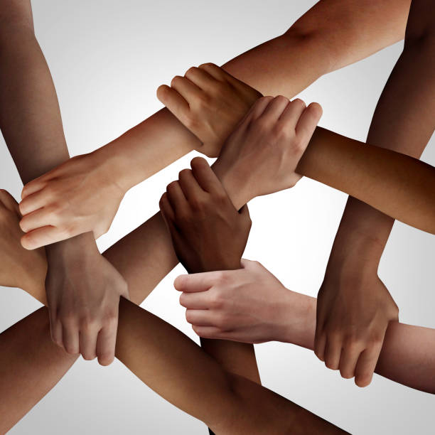 Racism Racism and human civil rights as diverse people of different ethnicity holding hands together as a social solidarity concept of a multiracial group working as united partners. social justice concept stock pictures, royalty-free photos & images